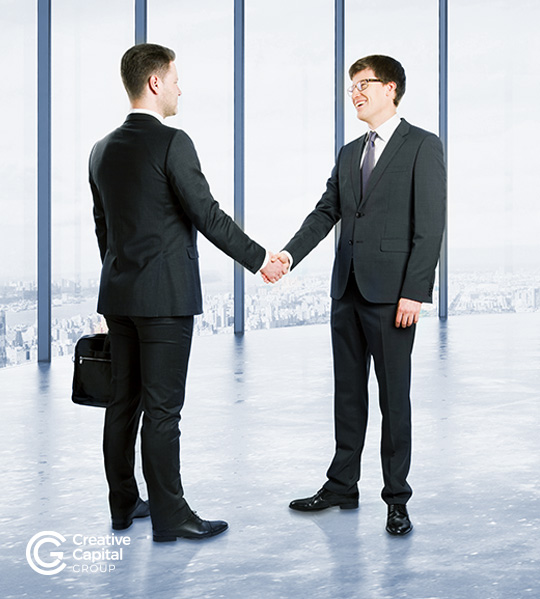 shaking hands with client